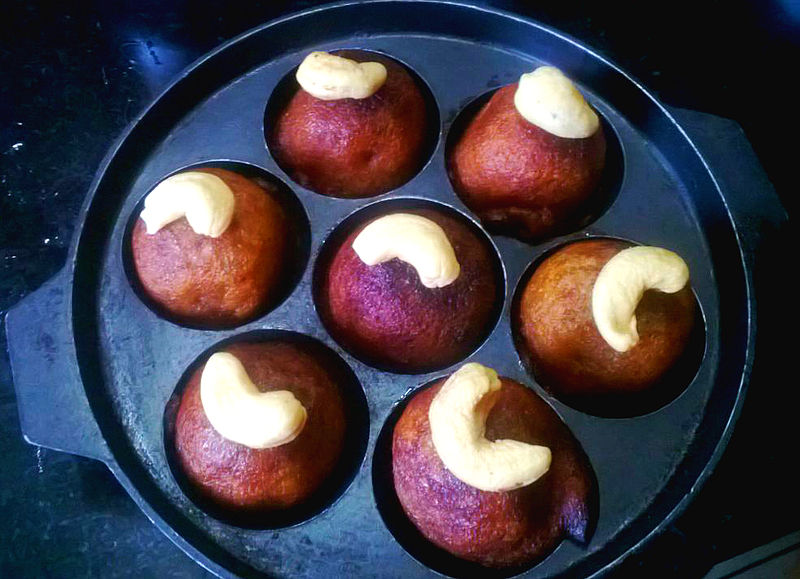 Unni Appam with cashews on top