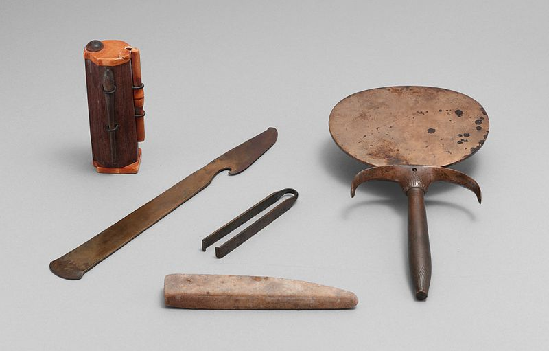 An ancient Egyptian cosmetic set, including a Kohl ash tube (upper left).